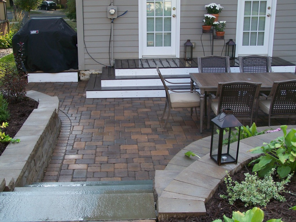 Small deck designed to match stone patio.